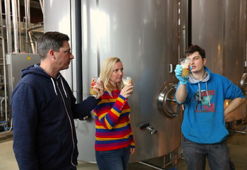 Owners Johan and Karen with brewer Dries