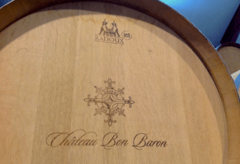 Wine barrel in the cellar of Château Bon Baron